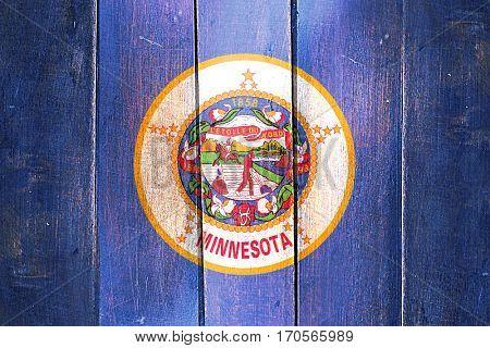 Vintage minnesota flag on grunge wooden panel
