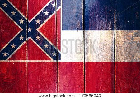 Vintage mississippi flag on grunge wooden panel