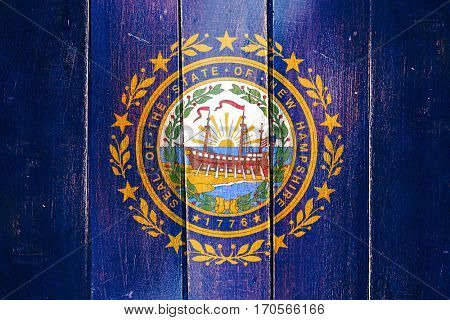 Vintage new hampshire flag on grunge wooden panel
