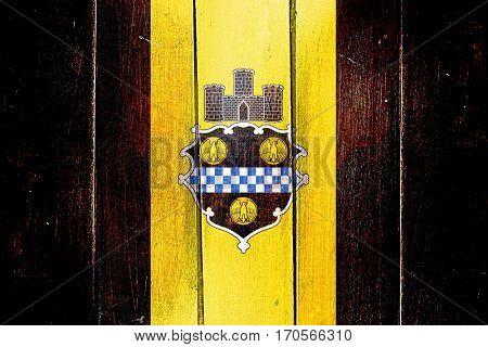 Vintage Pittsburgh flag on grunge wooden panel