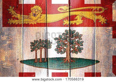 Vintage Prince edward island flag on grunge wooden panel