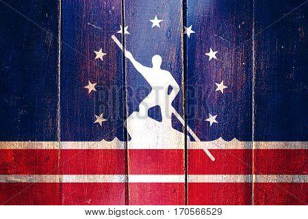 Vintage Richmond flag on grunge wooden panel
