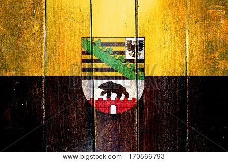Vintage Saxony anhalt, sachsen flag on grunge wooden panel