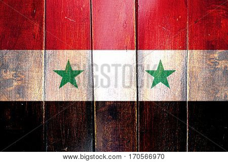 Vintage Syria  flag on grunge wooden panel