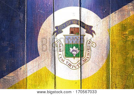Vintage Winnipeg flag on grunge wooden panel