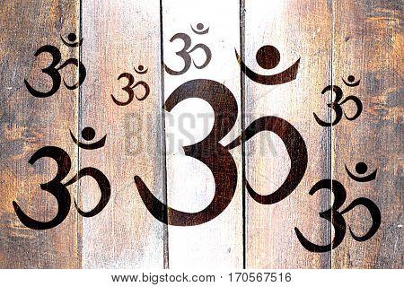 Vintage Om / aum symbol on a grunge wooden panel