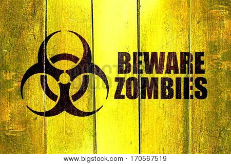 Vintage Beware zombies on a grunge wooden panel