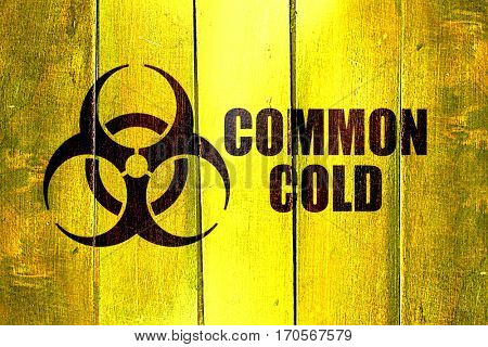 Vintage Common Cold on a grunge wooden panel