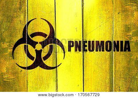 Vintage Pneumonia on a grunge wooden panel