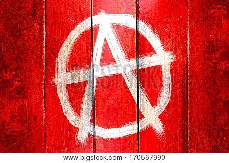Vintage Anarchist sign on a grunge wooden panel