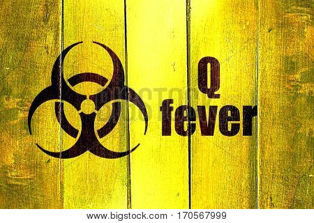 Vintage Q fever on a grunge wooden panel