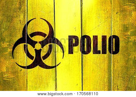 Vintage Polio on a grunge wooden panel