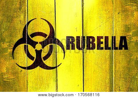 Vintage Rubella on a grunge wooden panel