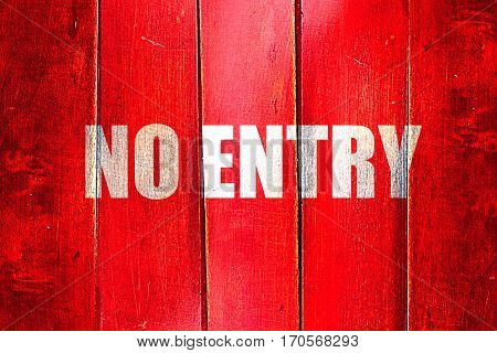 Vintage no entry symbol on a grunge wooden panel