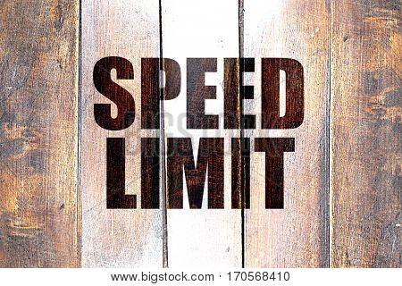 Vintage speed limit on a grunge wooden panel