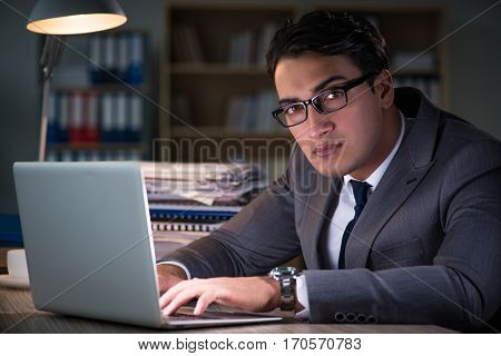Man staying in the office for long hours