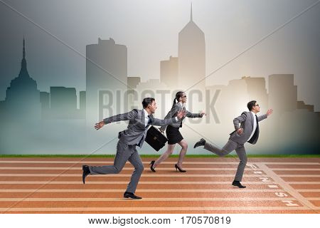 Businesspeople running in competition concept