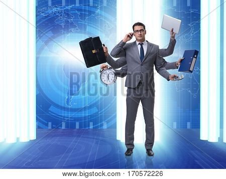 Young businessman in multitasking concept