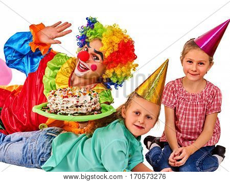 Birthday child clown playing with children. Kid holiday cakes celebratory in hands of events organizer man. Fun of group people lying floor on white background.