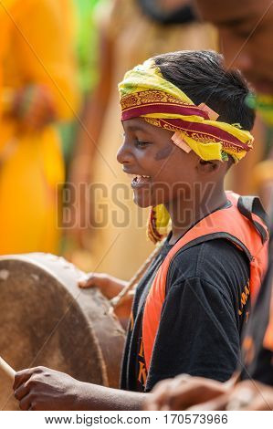 Georgetown Penang Malaysia - February 9 2017 : Young musician boy as a Hindu devotee taking part in the Thaipusam festival on February 9 2017 in Malaysia. Hindu festival to worship God Muruga.