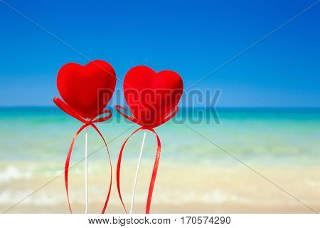 Two hearts on the beach.