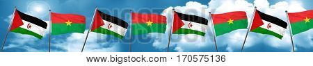 Western sahara flag with Burkina Faso flag, 3D rendering