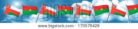Oman flag with Burkina Faso flag, 3D rendering