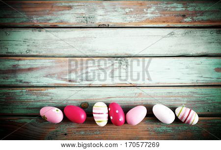 Easter egg decorations on wooden background