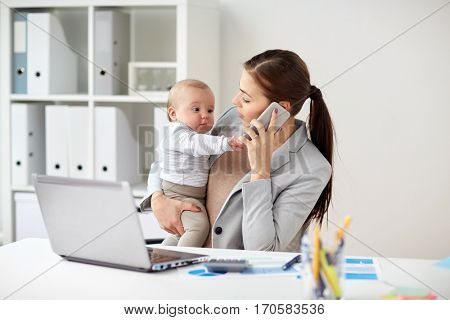business, motherhood, multi-tasking, family and people concept - smiling businesswoman with baby calling on smartphone at office
