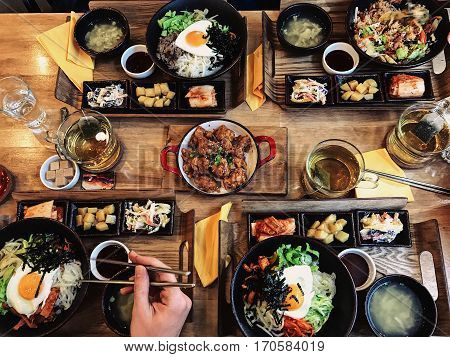 Healthy food on wooden table. Top view. people having dinner in the restaurant.