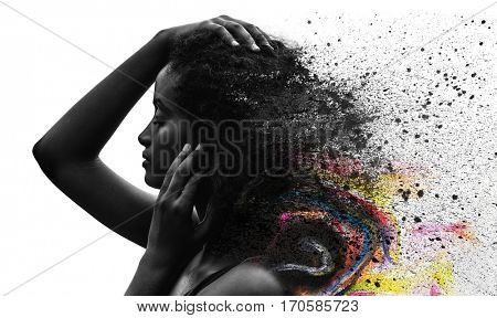 Elegant dark-skinned woman's photograph combined with splatter of ink and colorful paint