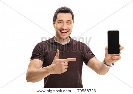 Happy man showing a phone and pointing isolated on white background
