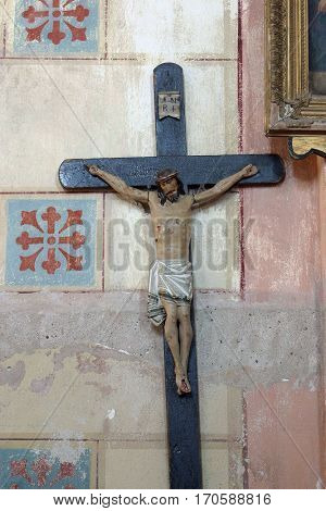 KRATECKO, CROATIA - JULY 16: Cross in Parish Church of Saint Roch in Kratecko, Croatia on July 16, 2010.