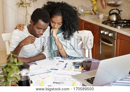 Young Dark-skinned Couple Trying To Escape Eviction From Their Apartment, Calculating Domestic Finan