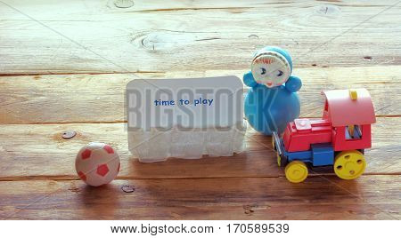 train roly-poly old ball and paper note on a wooden table retro style image