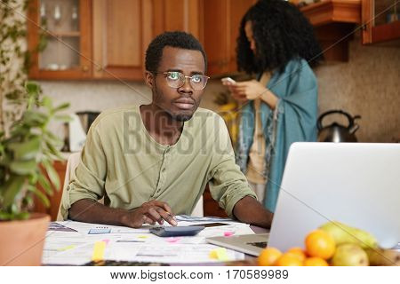 Sad Unemployed African Male Wearing Glasses Having Stressed Look, Realizing That He Is Not Able To P