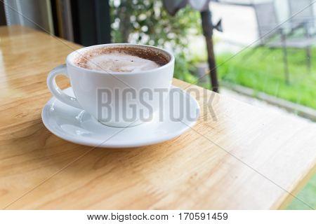 hot coffee mocha with foam milk in countryside cafe