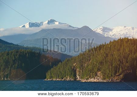 Alaskan fjords at summer time sunny day. Panoramic view on Norwegian fjords