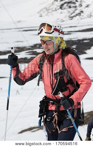AVACHA VOLCANO KAMCHATKA PENINSULA RUSSIAN FEDERATION - APRIL 21 2012: Portrait of young woman equipped ski mountaineer - participating in Open Cup of Russia on Ski Mountaineering on Kamchatka.