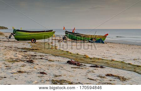 Fishing boats at sandy beach of the Baltic Sea