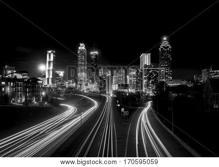 Atlanta Skyline at night, high contrast black and white with light trails poster