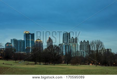 View of midtown Atlanta in pre-dawn hours with park in foreground