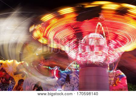 LAWRENCEVILLE, GA - SEPTEMBER 2016:  A composite of two images shows motion blur of fast-moving ride at the Gwinnett County Fair in Lawrenceville GA on September 17 2016.