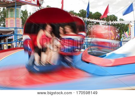 LAWRENCEVILLE, GA - SEPTEMBER 2016:  Motion blur shows movement of fast-moving carnival ride at the Gwinnett County Fair in Lawrenceville GA on September 17 2016.