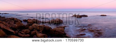 A pink sunset at Point Piquet near Dunsborough and Margaret River in the South West of Western Australia. Panoramic.