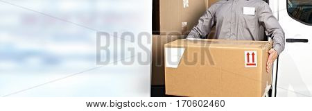 Delivery postman hands with a box