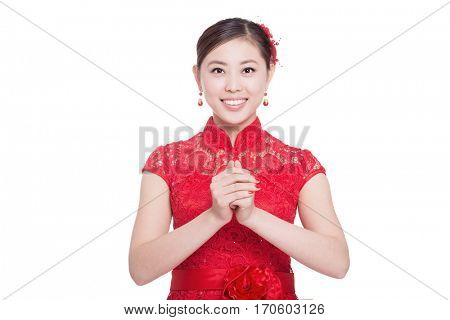 young chinese woman in red cheongsam with greeting gesture in chinese new year on white background