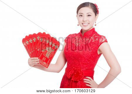 young asian woman in red cheongsam holds red envelope in chinese new year