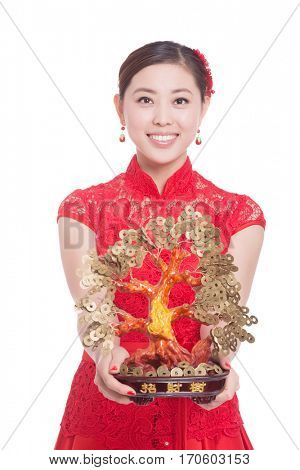 young asian woman in red cheongsam holds lucky tree in chinese new year