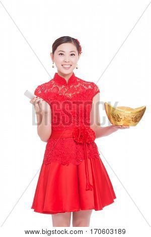 young asian woman in red cheongsam holds gold ingot and mobile phone in chinese new year